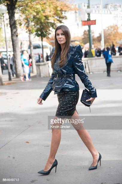 Fashion director Christina Pitanguy wears a Mugler jacket skirt and bag and Jimmy Choo shoes day 5 of Paris Womens Fashion Week Spring/Summer 2018 on...