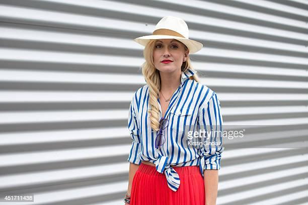 Fashion Director for The Rake magazine Sarah Ann Murray wearing a mango skirt Ralph Lauren shirt Italian Independent sunglasses and a Lock and Co hat...