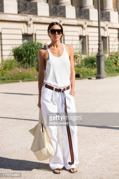 Fashion Director for Vogue Ukraine ambassador Julie Pelipas wears a Celine bag and sunglasses Better vest and trousers on July 02 2019 in Paris France