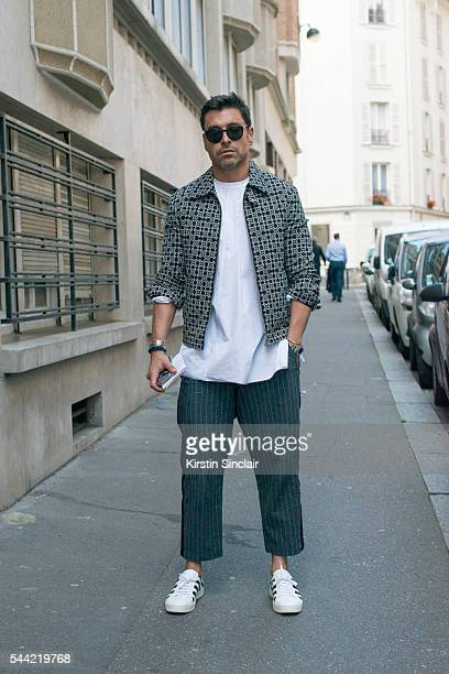 Fashion Director for WWD Alex Badia wears a Neil Barret jacket Marni shirt Sacai trousers and Off White trainers on day 1 of Paris Collections Men on...