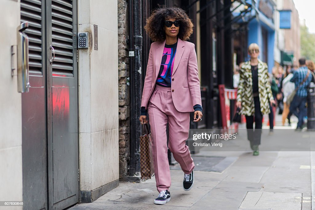 Fashion Director Instyle Germany Jan-Michael Quammie wearing a pink suit, Louis Vuitton bag and Vans outside Mary Katrantzou during London Fashion Week Spring/Summer collections 2017 on September 18, 2016 in London, United Kingdom.