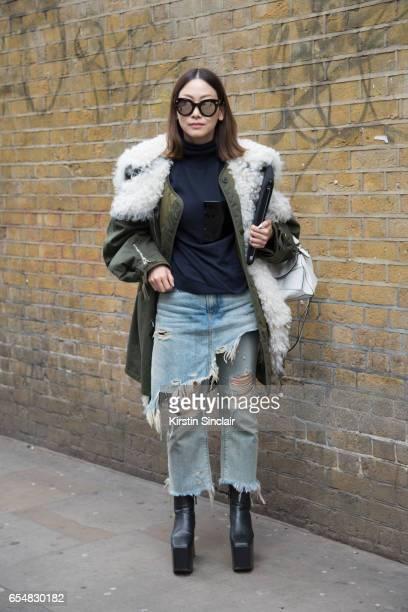 Fashion director Maiko Shibata wears a Balenciaga parka jacket and shoes R13 jeans Loewe bag and Soya sunglasses on day 5 of London Womens Fashion...