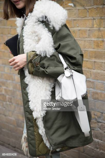 Fashion director Maiko Shibata wears a Balenciaga parka jacket and Loewe bag on day 5 of London Womens Fashion Week Autumn/Winter 2017 on February 21...