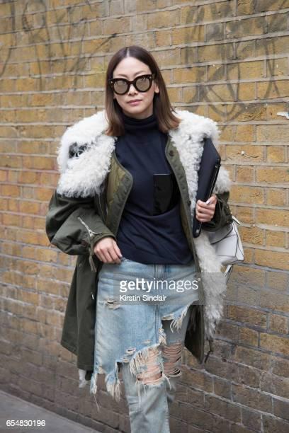 Fashion director Maiko Shibata wears a Balenciaga parka jacket R13 jeans Loewe bag and Soya sunglasses on day 5 of London Womens Fashion Week...