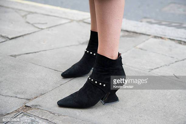 Fashion director Mosha Lundstrom Halbert wears Dorateymur boots day 4 of London Womens Fashion Week Spring/Summer 2016 on September 19 2016 in London...