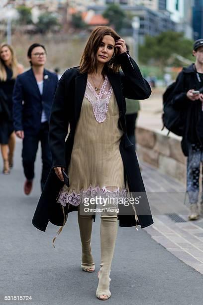 Fashion Director Vogue Australia Christine Centenera wearing a beige dress black long wool coat and overknees peep toes as shoes outside Toni...