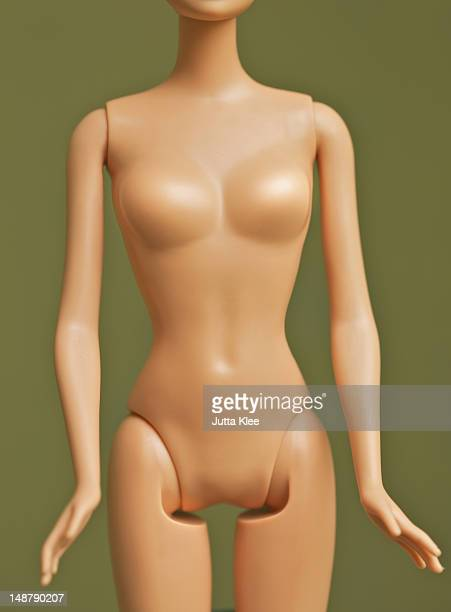 fashion doll manipulated to have big chest