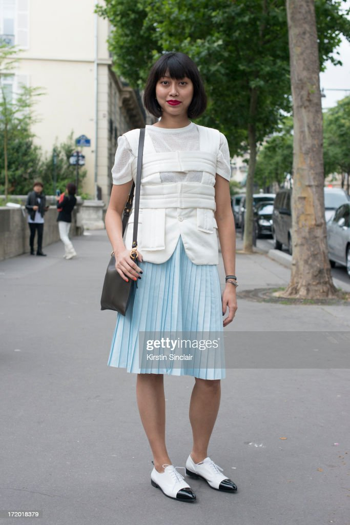 Fashion Ediotor for mens Elle Magazine China Yoyo Lu wears Prada shoes, Comme Des Garcons top, Marni Bag, Cos skirt and t-shirt on day 3 of Paris Collections: Men on June 28, 2013 in Paris, France.