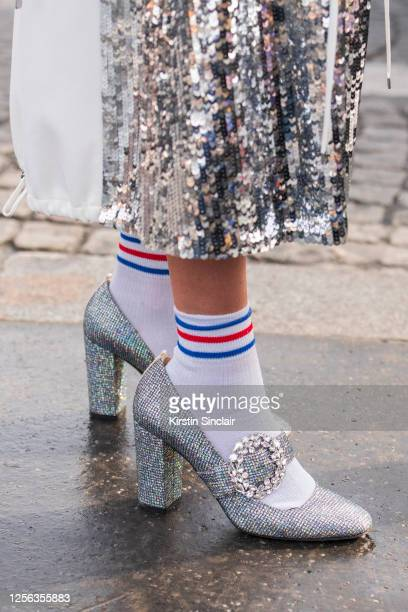 Fashion editor Anahita Moussavian wears a Tibi dress and SJP shoes on March 03, 2020 in Paris, France.