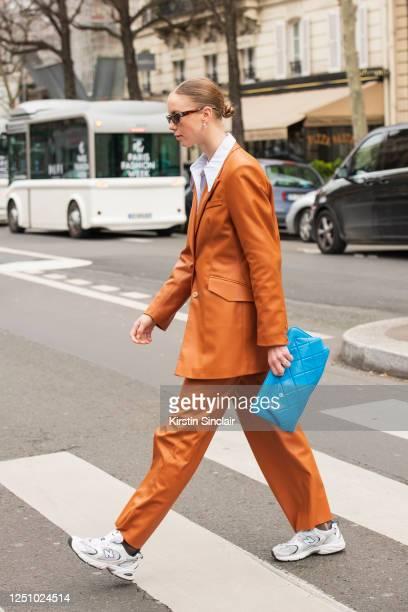Fashion editor and stylist Hilda Sandstrom wears a Nanushka suit, Ganni shirt, Gestuz bag, New Balance trainers and Flatlist sunglasses on March 01,...