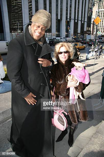 Fashion Editor Andre Leon Talley and Lucy Anne pose for photos outside of the main tent during Olympus Fashion Week Fall 2005 at Bryant Park February...