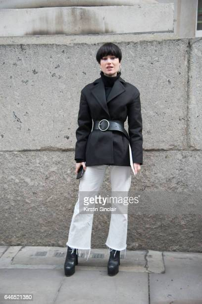 Fashion editor at British Vogue Julia Hobbs wears And Other Stories coat and Vetements boots on day 2 of London Womens Fashion Week Autumn/Winter...