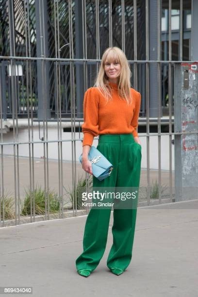 Fashion Editor at Costume Magazine Jeanette Friis Madsen wears a JW Anderson bag Frame sweater HM trousers and Balenciaga shoes day 3 of Paris Womens...
