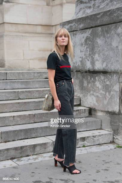 Fashion Editor at Costume Magazine Jeanette Friis Madsenwears a Paco Rabanne Tshirt and bag Vetements jeans and Celine shoes day 3 of Paris Womens...