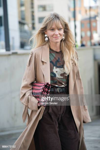Fashion editor at Costume Magazine Jeanette Madsen wears a Balenciaga clutch bag Week day t shirt H and M jacket AF Agger trousers on day 4 of London...