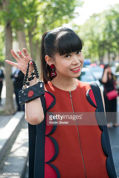 Fashion Editor at Elle China Leaf Greener wearing a Chanel iphone cover and Delpozo dress day 3 of Paris Haute Couture Fashion Week Autumn/Winter...