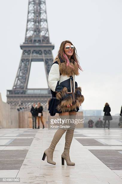 Fashion Editor at large for Vogue Japan Anna Dello Russo wearing a Sacai jacket Celine boots and Chanel sunglasses on day 7 during Paris Fashion Week...