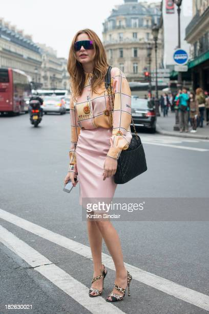 Fashion editor at large of Vogue Turkey Ece Sukan wears a vintage top top Shop skirt Brian Attwood shoes and Venice Beach sunglasses on day 7 of...