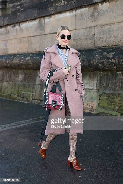 Fashion editor at stylecom Harriet Hawksworth wears an Acne coat Sonia Rykiel Topshop shoes Miu Miu sunglasses and a vintage skirt on day 4 during...
