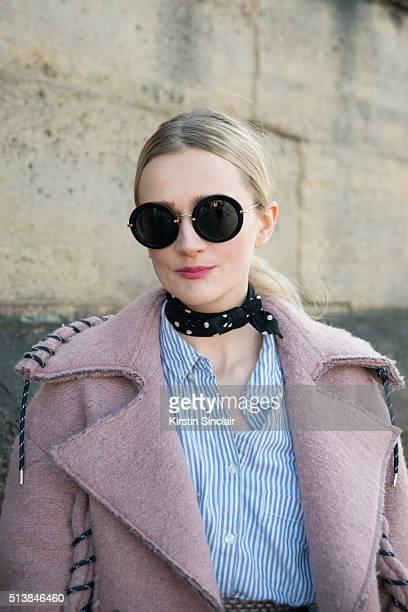 Fashion editor at stylecom Harriet Hawksworth wears an Acne coat Sonia Rykiel Miu Miu sunglasses on day 4 during Paris Fashion Week Autumn/Winter...