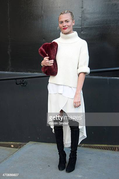 Fashion editor at The Debrief Pandora Sykes wears And Other Stories jumper Equipment shirt Warehouse skirt Stuart Weitzman boots and Reformation bag...