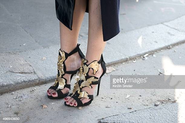Fashion Editor at The Rake Esther Quek wears a Harry Halim skirt and Giuseppe Zanotti shoes on day 6 during Paris Fashion Week Spring/Summer 2016/17...