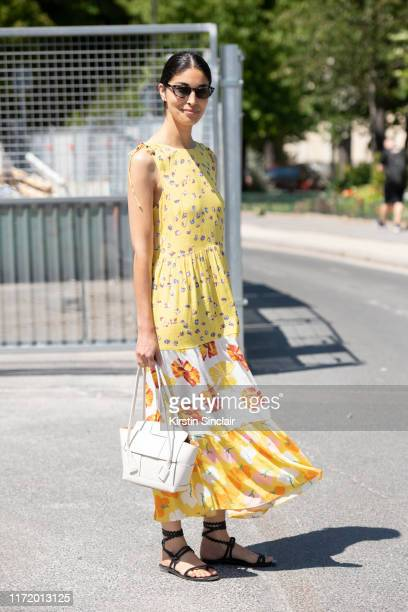 Fashion editor Caroline Issa wears Bottega Veneta bag Label/Mix dress Alvaro sandals on July 02 2019 in Paris France