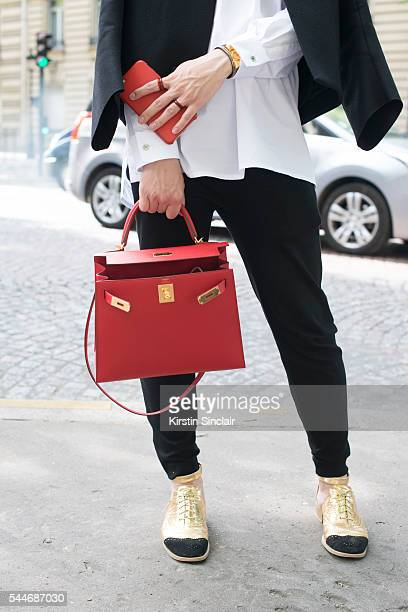 Fashion Editor Christian NG wearing an Hermes shirt and bag Lanvin trousers Celine jacket and Chanel shoes on day 4 of Paris Collections Men on June...