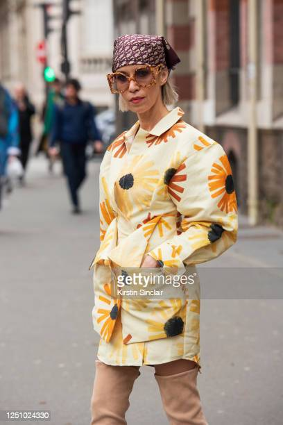 Fashion editor Denisa Palsha wears a Dior head scarf, Jacquemus dress, Poppy Lissiman sunglasses and camel knee high suede boots on March 01, 2020 in...