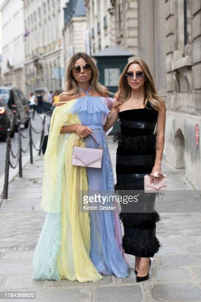 Fashion editor Erica Pelosini Leeman wears a Ralph and Russo dress and bag and Chloe sunglasses with Katia Francesconi wearing Pomellato sunglasses...