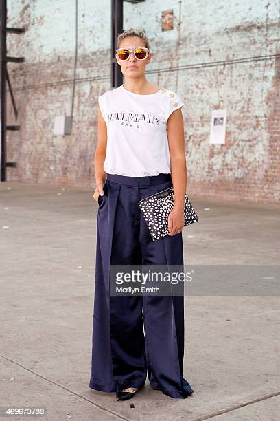Fashion Editor for Daily Telegraph Elle Halliwell wears Karen Walker sunglasses Balmain top Givency bag Iconic trousers and Valentino shoes at...
