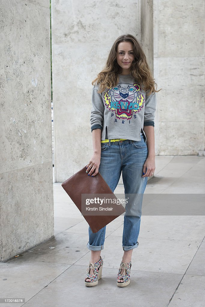 Fashion Editor for GQ France Victoria Cassagnaud wears J brand jeans, a Hackettet bag, Kenzo sweater and Claudie Pierlot shoes on day 3 of Paris Collections: Men on June 28, 2013 in Paris, France.