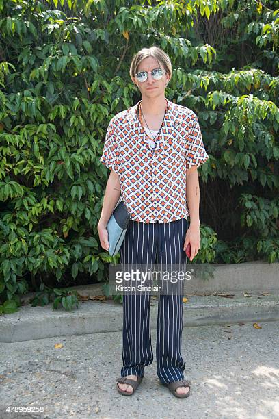 Fashion editor for GQ Gary Armstrong wears Topman shirt Prada trousers Givenchy clutch Birkenstock shoes and Rayban sunglasses on day 2 of Paris...