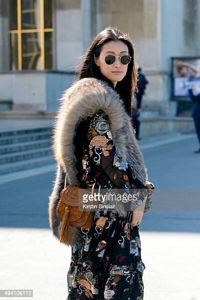 Fashion Editor for Hong Kong Tatler Justine Lee wears a Chloe dress and bag and Rayban sunglasses on day 3 during Paris Fashion Week Spring/Summer...