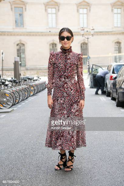 Fashion Editor for Hong Kong Tatler Justine Lee wears a YSL dress Gianvito Rossi shoes and Justine Lee 425 sunglasses day 2 of Paris Haute Couture...
