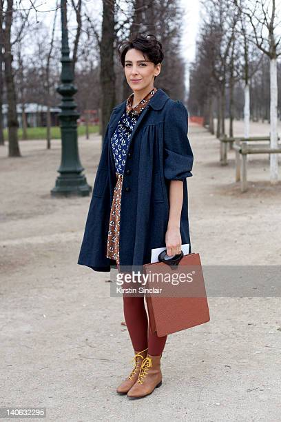 Fashion Editor for Marie Claire Turkey Ceylan Atinc wearing an Opening ceremony dress Etro shoes Vintage Louis Vuitton bag Vinage Jacket at Paris...