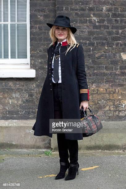 Fashion Editor for the Rake Sarah Ann Murray wearing Saint Laurent boots Ralph Lauren Polo bag Ralph Lauren coat Bespoke shirt and shorts Vintage hat...