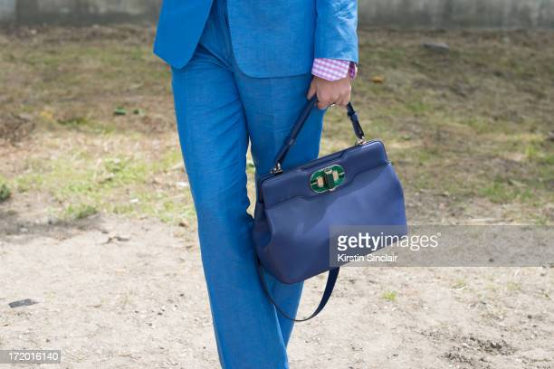 Fashion Editor for the Rake Sarah Ann Murray wears Italia a Bespoke Q menswear suit and shirt and a bvlgari bag on day 4 of Paris Collections Men on...