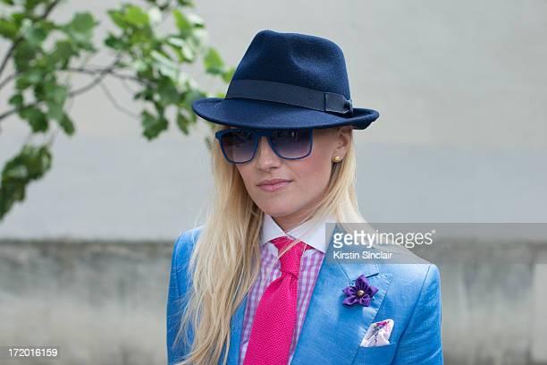 Fashion Editor for the Rake Sarah Ann Murray wears Italia Independent sunglasses a Bespoke Q menswear suit and shirt Bates hat Marinella tie Dior...