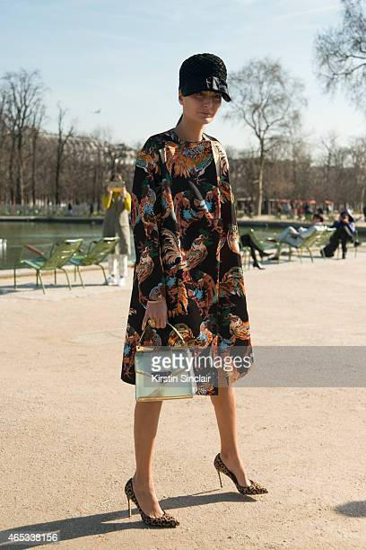 Fashion editor Giovanna Battaglia wears Rochas coat vintage hat and Sara Battaglia bag on day 3 of Paris Collections Women on March 05 2015 in Paris...