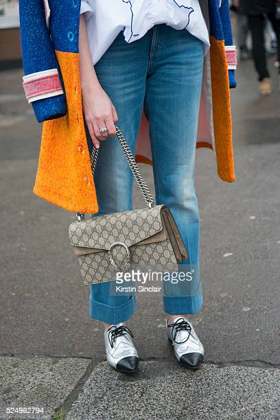 Fashion Editor Juliet Belkin wears Chanel shoes and Gucci bag on day 7 during Paris Fashion Week Autumn/Winter 2016/17 on March 7 2016 in Paris...