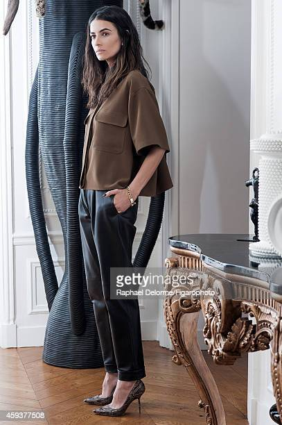 Fashion editor Leila Yavari is photographed for Madame Figaro on May 20, 2014 in Paris, France. Shirt , pants , shoes , bracelet . Sculpture by...