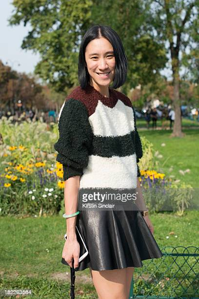 Fashion Editor of Lucky magazine Eva Chan wears an Isabel Marrant jumper Thakoon skirt and a Whistles bag on day 5 of Paris Fashion Week...