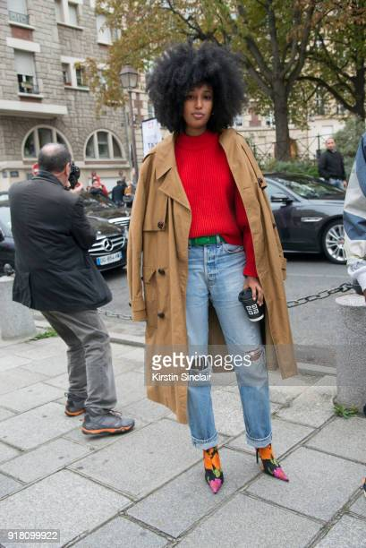 Fashion Editor of Wonderland magazine Julia Sarr Jamois wears a Balenciaga coat and boots and Levi's jeans day 6 of Paris Womens Fashion Week...