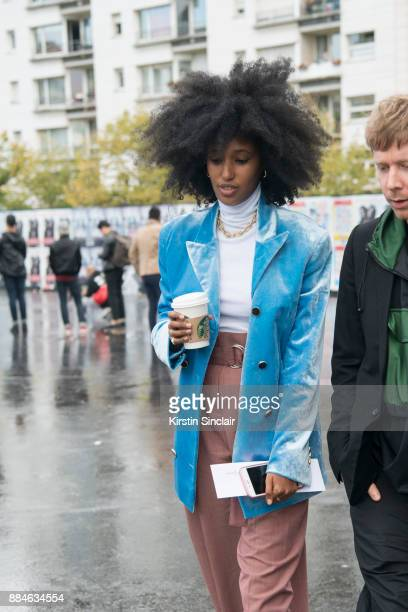 Fashion Editor of Wonderland magazine Julia SarrJamois wears Celine trousers and a Hillier Bartley jacket day 5 of Paris Womens Fashion Week...