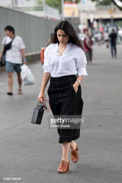 Fashion editor Purple Magazine Sheila Single wears Zanya shirt Christophe Lemaire skirt Medea bag and Roger Vivier shoes during Haute Couture Fall...