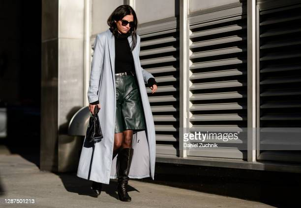 Fashion Editor Schanel Bakkouche is seen on the streets of Manhattan wearing a Michelle Waugh blue coat, The Row black turtleneck, The Frankie Shop...