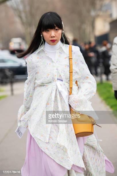 Fashion editor Susie Lau wears all Loewe with Miu Miu earrings on February 28, 2020 in Paris, France.