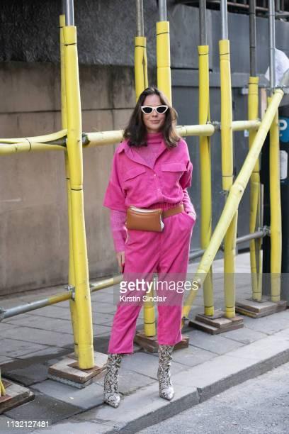 Fashion Editor Thérèse Hellstrom wears Co'Couture jumpsuit, Day Birger et Mikkelsen jumper, Elleme bag, Mango boots and Celine sunglasses during...