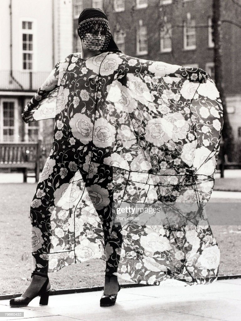 Fashion, England, 15th February 1971, A floating silk floral print chiffon outfit with a beaded mask from designer Thea Porter is modelled in London